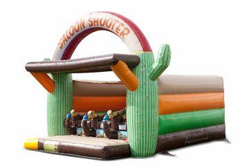 Koop Schiettent Western springkussen met kanon spel voor kinderen. Bestel springkussens online bij JB Inflatables Nederland