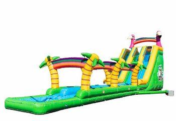 Bestel Drop & Slide Jungle Springkussen met dubbele glijbaan voor kinderen. Koop springkussens online bij JB Inflatables Nederland