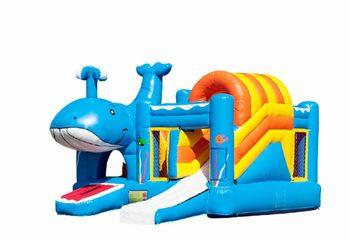 Opblaasbaar multiplay springkussen met glijbaan en obstakels in walvis thema kopen voor kinderen.  Bestel opblaasbare springkussens online bij JB Inflatables Nederland