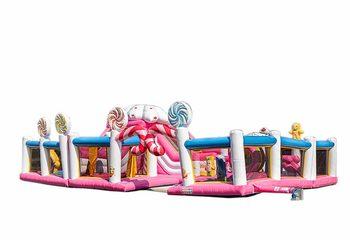 Groot opblaasbaar springkussen in candy thema kopen voor kinderen. Bestel springkussens online bij JB Inflatables Nederland