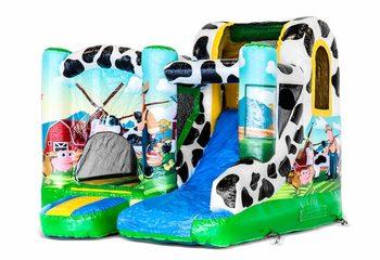 Klein opblaasbaar springkussen met glijbaan kopen in thema boerderij voor kinderen. Bestel opblaasbare springkastelen online bij JB Inflatables Nederland
