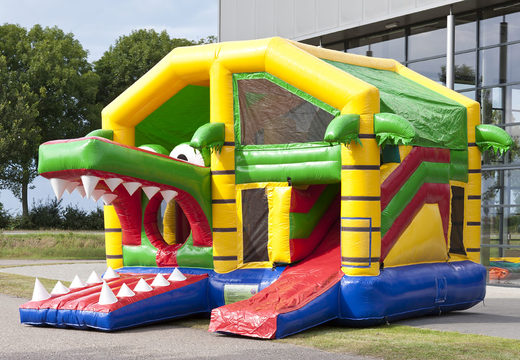 Springkasteel in thema krokodil met een glijbaan kopen voor kinderen. Bestel opblaasbare springkastelen online bij JB Inflatables Nederland