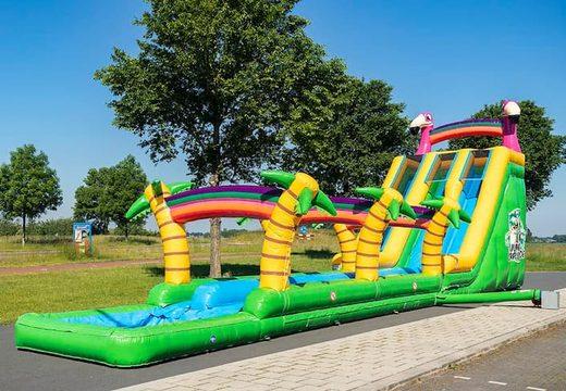 Koop Drop & Slide Jungle Springkussen met dubbele glijbaan voor kinderen. Bestel springkussens online bij JB Inflatables Nederland