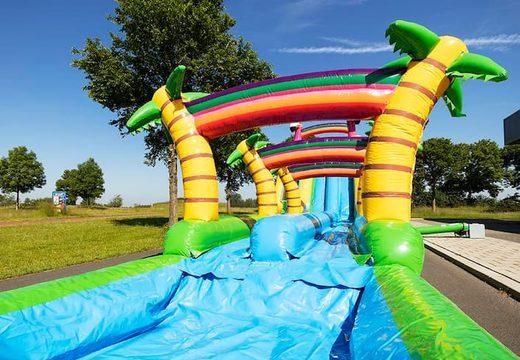 Bestel Drop & Slide Jungle Springkussen met dubbele glijbaan voor kinderen. Koop opblaasbare springkussens online bij JB Inflatables Nederland