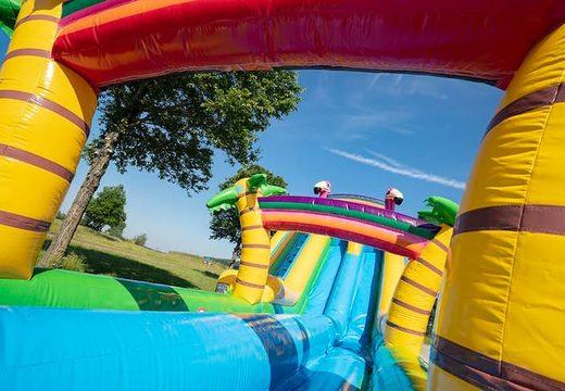 Bestel Drop & Slide Jungle Springkussen met dubbel glijbaan voor kinderen. Koop springkussens online bij JB Inflatables Nederland