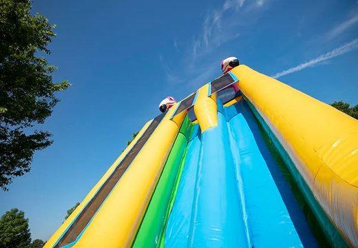 Koop Drop & Slide Jungle springkasteel met dubbele glijbaan voor kinderen. Bestel opblaasbare springkastelen online bij JB Inflatables Nederland