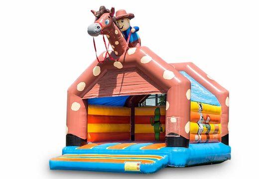 Groot overdekt springkussen kopen in thema cowboy western voor kinderen. Bestel springkussens online bij JB Inflatables Nederland
