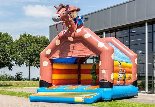 Super springkussen overdekt kopen in cowboy thema voor kinderen. Koop springkussen online bij JB Inflatables Nederland