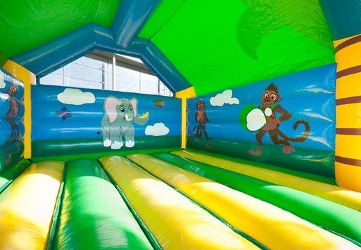 Groot springkasteel overdekt kopen met vrolijke animaties in jungle thema voor kinderen. Koop springkastelen online bij JB Inflatables Nederland