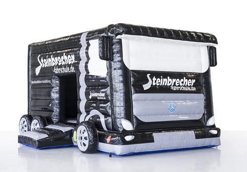 Promotionele maatwerk Steinbrecher fashrschule bus springkussen in zwart online kopen. Bestel nu opblaasbare springkussens voor evenementen in eigen huisstijl bij JB Inflatables Nederland