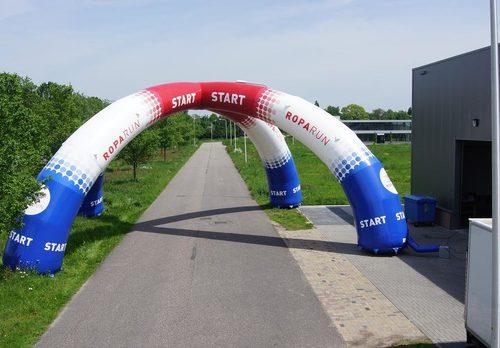 Bestel maatwerk start & finishboog van roparun voor sport evenementen bij JB Promotions Nederland.  Koop nu op maat gemaakte opblaasbare reclamebogen online